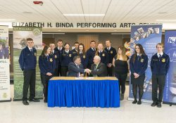 MSU IAT Director Dr. Randy Showerman, left, shakes hands with KCC President Mark O'Connell as FFA students look on after the two officials signed an inter-institutional understanding agreement formalizing the ag program partnership at KCC on March 6.