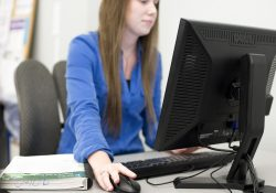 A student works on a computer in a KCC computer lab.