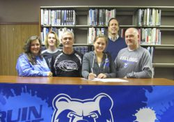 Pictured from left to right are Jeanine Winkler (mother); Jeremy Winkler (brother); Attack Basketball coach Alton Tucker; KCC women's basketball recruit Nina Winkler; head KCC women's basketball coach Dic Doumanian; and Jeff Winkler (father).