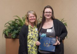 Cory Farfan, right, accepts the award for Outstanding Office Information Technology Graduate 2017 from KCC OIT instructor Robin Hunter at the College's annual Awards Banquet ceremony, held at the Battle Creek Country Club on April 27.