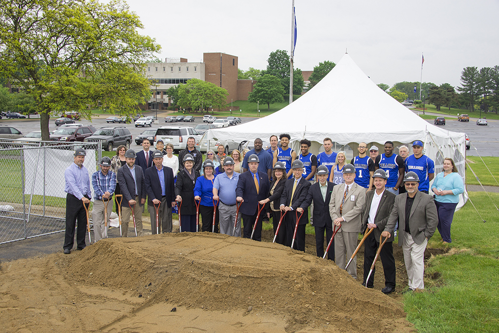 Representatives from Kellogg Community College and the Miller Foundation break ground at the construction site of the new Miller Physical Education Building on the college's North Avenue campus in Battle Creek.