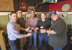 From left to right, Jeremy Wilson, Blair Foljahn, KCC Director of Public Information and Marketing Eric Greene, Territorial co-owner Charles Grantier and head Territorial brewer and co-owner Tim Davis taste Bruin Brew beer brewed for KCC's 60th anniversary at Territorial Brewing Company.