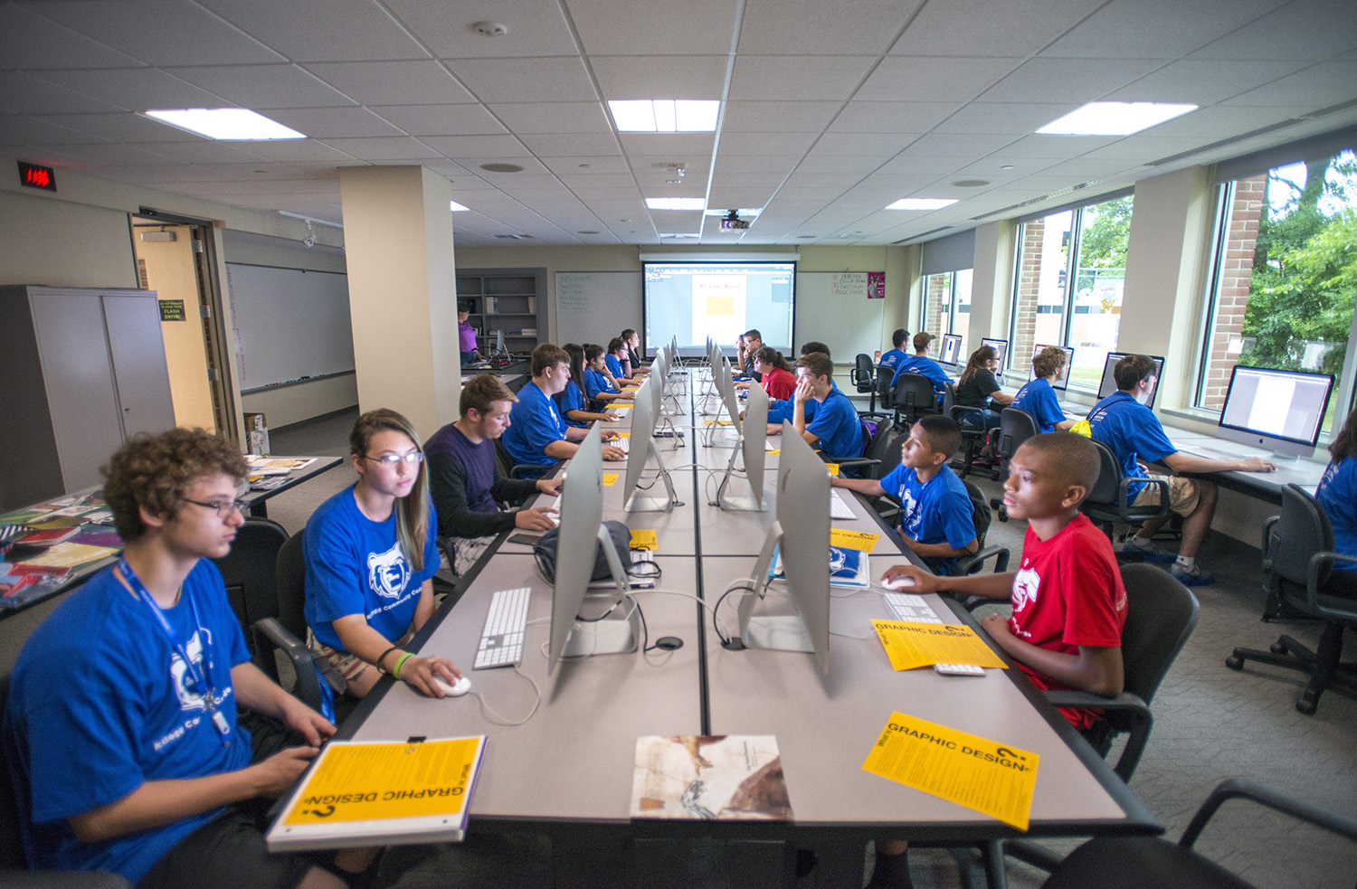 Youth summer campers work on computers during a summer camp at KCC.