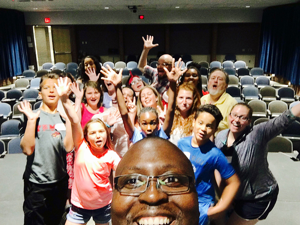 KCC professor Gerald Blanchard takes a selfie with campers from KCC's 2017 Summer Music & Theater Performance Camp.
