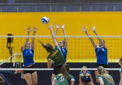 KCC women's volleyball players go up for a block against a player from Glen Oaks during a home match on Sept. 7, 2017.