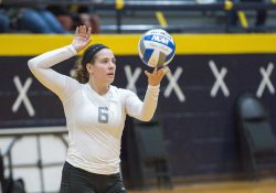 KCC volleyball player Kameron Haley prepares a serve.