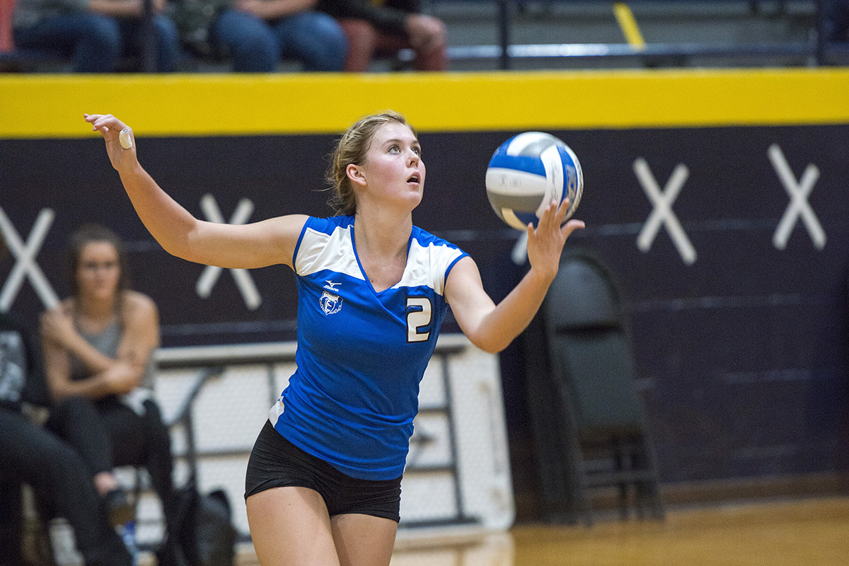 KCC volleyball player Hannah Landis prepares to serve the ball.