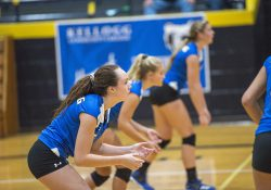 KCC volleyball player Kim Kusler waits for a serve during a home match in Battle Creek.