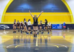 KCC volleyball players celebrate a point against Jackson College.