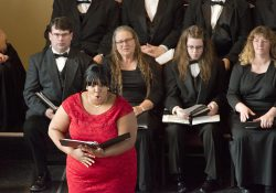 Music instructor Carmen Bell sings onstage during a performance at a church in downtown Battle Creek.