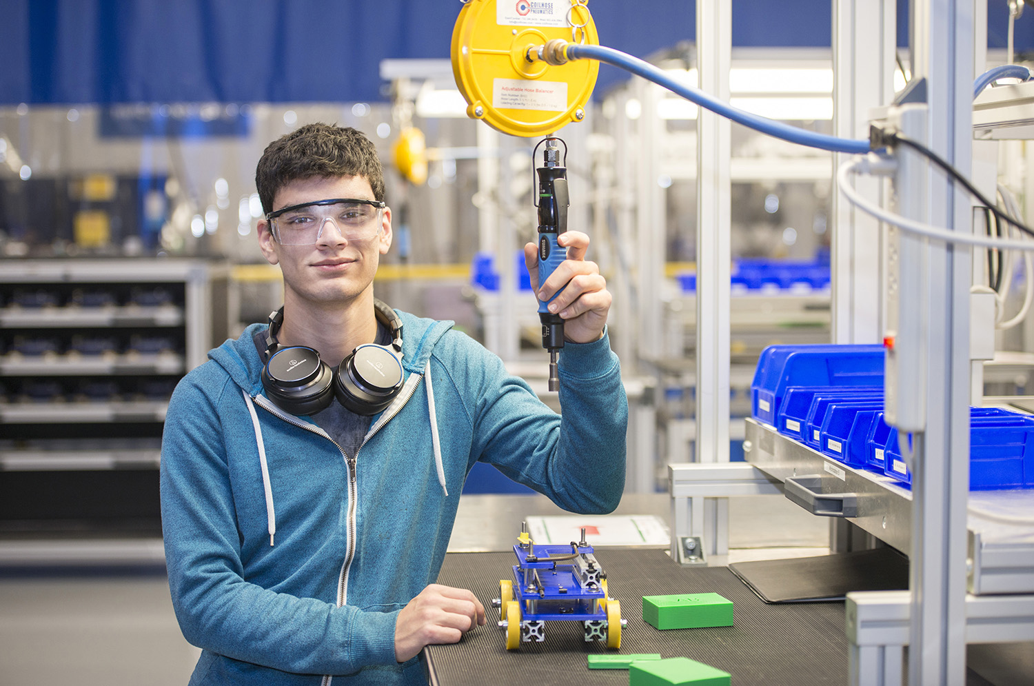 KCC student Devin Harook poses in the KAMA manufacturing training area of the RMTC.