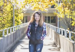 KCC student Jana Gardner poses on the bridge outside the Davidson Center on campus in Battle Creek.