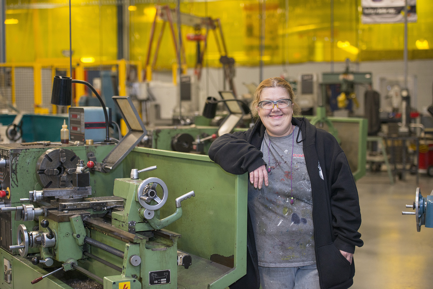 KCC student Karen Kelley poses for a photo at the Regional Manufacturing Technology Center campus in Battle Creek.