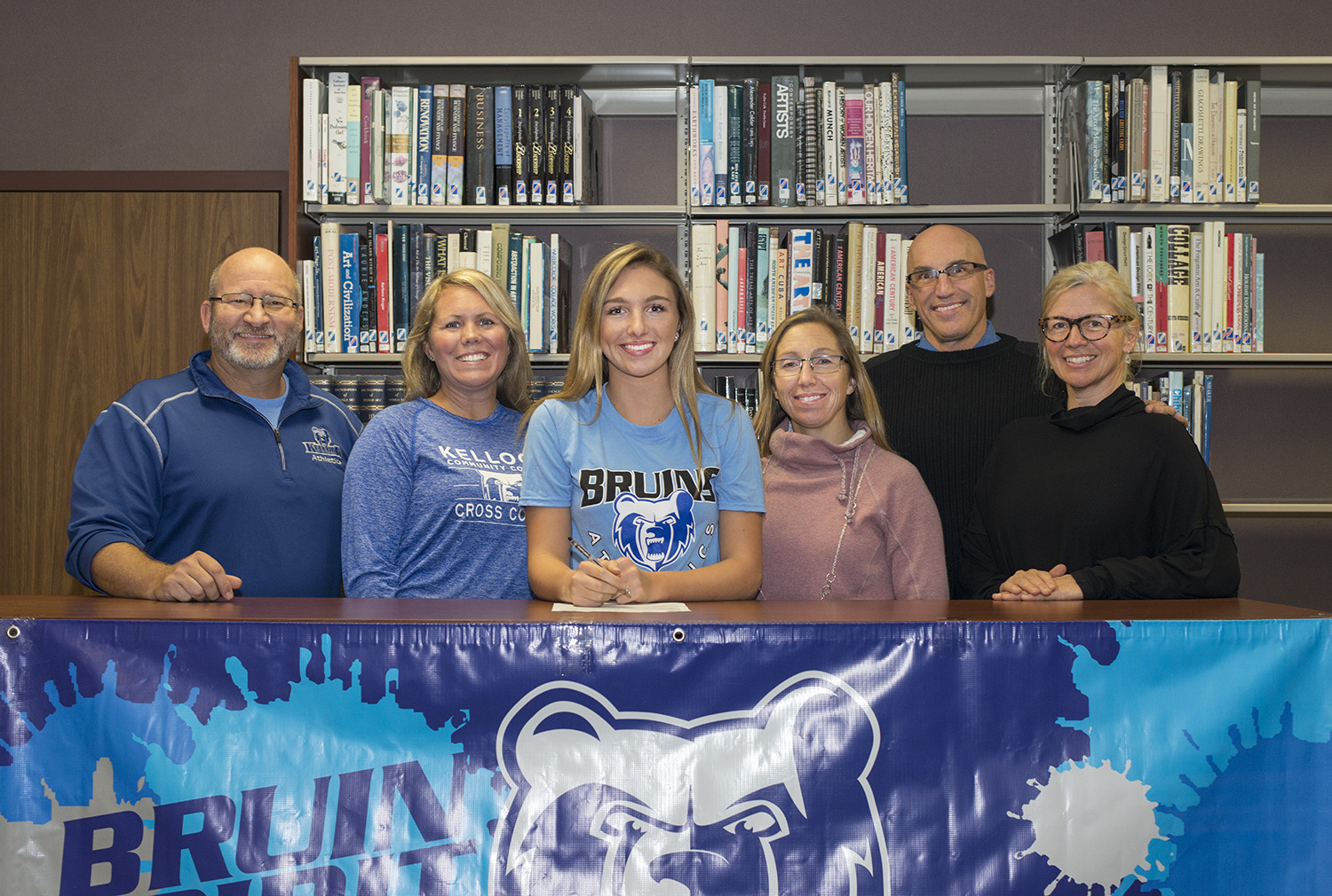 Pictured, from left to right, are KCC Athletic Director Tom Shaw, Head KCC Cross-Country Coach Erin Lane, KCC cross-country recruit Maggie Wood, Lakeview High School Girl's Cross-Country Coach Becky Pryor, Michael Wood (father) and Sheila Wood (mother).