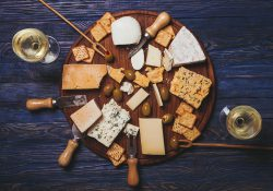 A stock photo featuring an overhead view of a cheese plate.