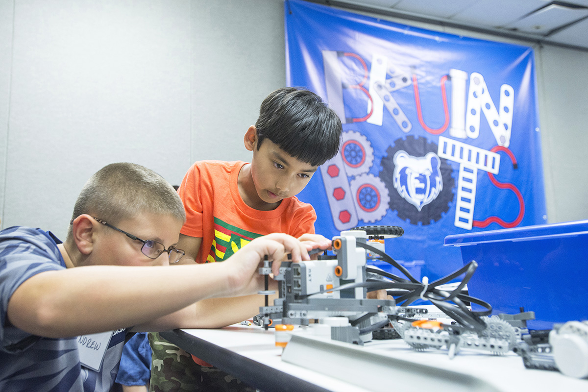 Youth Bruin Bots participants work on a robot during a robotics camp at the RMTC campus in Battle Creek.
