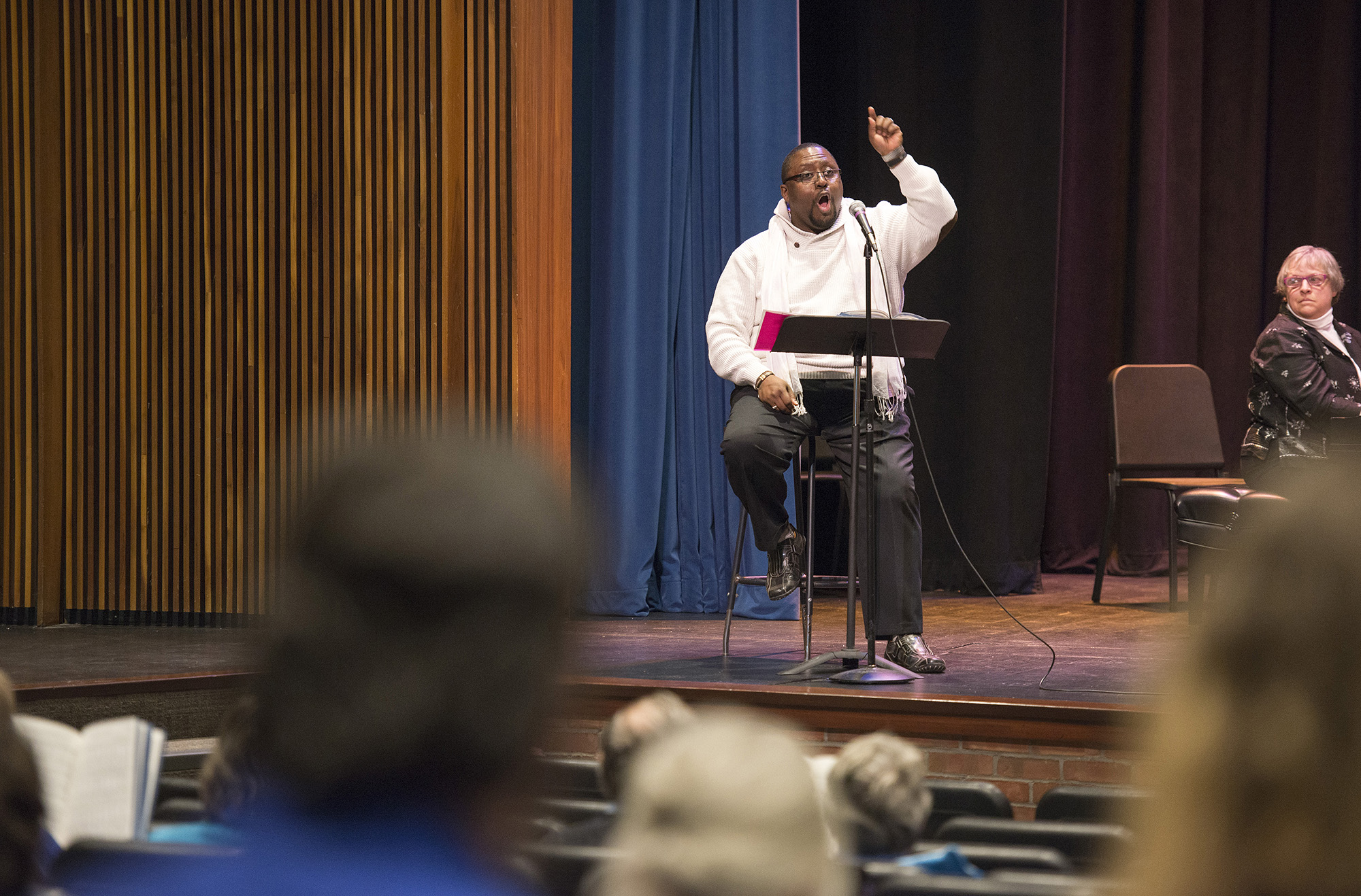 KCC Vocal Arts Director Dr. Gerald Case-Blanchard leads an audience in song in the Binda Performing Arts Center in 2017.
