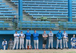KCC baseball players watch the team play from the dugout during a home game at Bailey Park in Battle Creek.