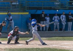 A KCC baseball player bats against Lake Michigan College at C.O. Brown Stadium in Battle Creek on April 12, 2018.