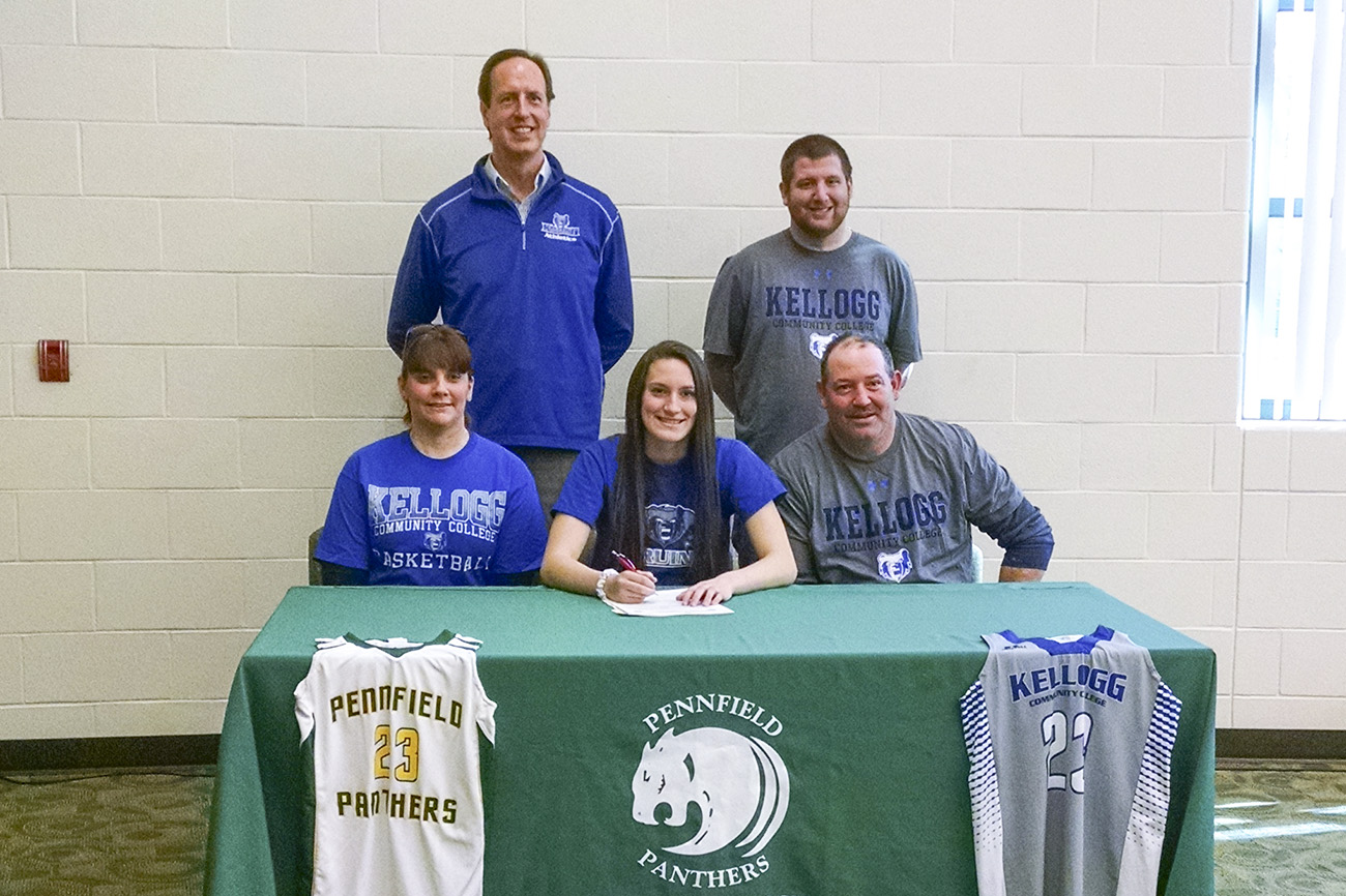 Pictured, in the front row, from left to right, are Shannon Abercrombie (mother), women's basketball signee Brianna Abercrombie and Eddie Abercrombie (father). In the back row, from left to right, are KCC's Head Women's Basketball Coach Dic Doumanian and Eddie Abercrombie (brother).