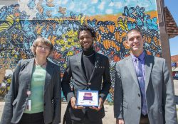 Pictured, from left to right, are KCC Media Design Manager Kathy Jarvie, artist Jaziel Pugh and KCC Director of Public Information and Marketing Eric Greene.