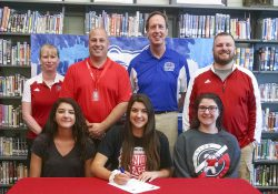 Pictured in the above photo, in the front row, from left to right, are Grace Smith (sister), Lyndsay Smith and Allyah Smith (sister). In the back row, from left to right, are Colon Junior/Senior High School Athletic Director Paige Smolarz, Colon Junior/Senior High School Principal Mike Rasmussen, KCC's Head Women's Basketball Coach Dic Doumanian and Colon's Varsity Girls Basketball Coach Robbie Hattan.