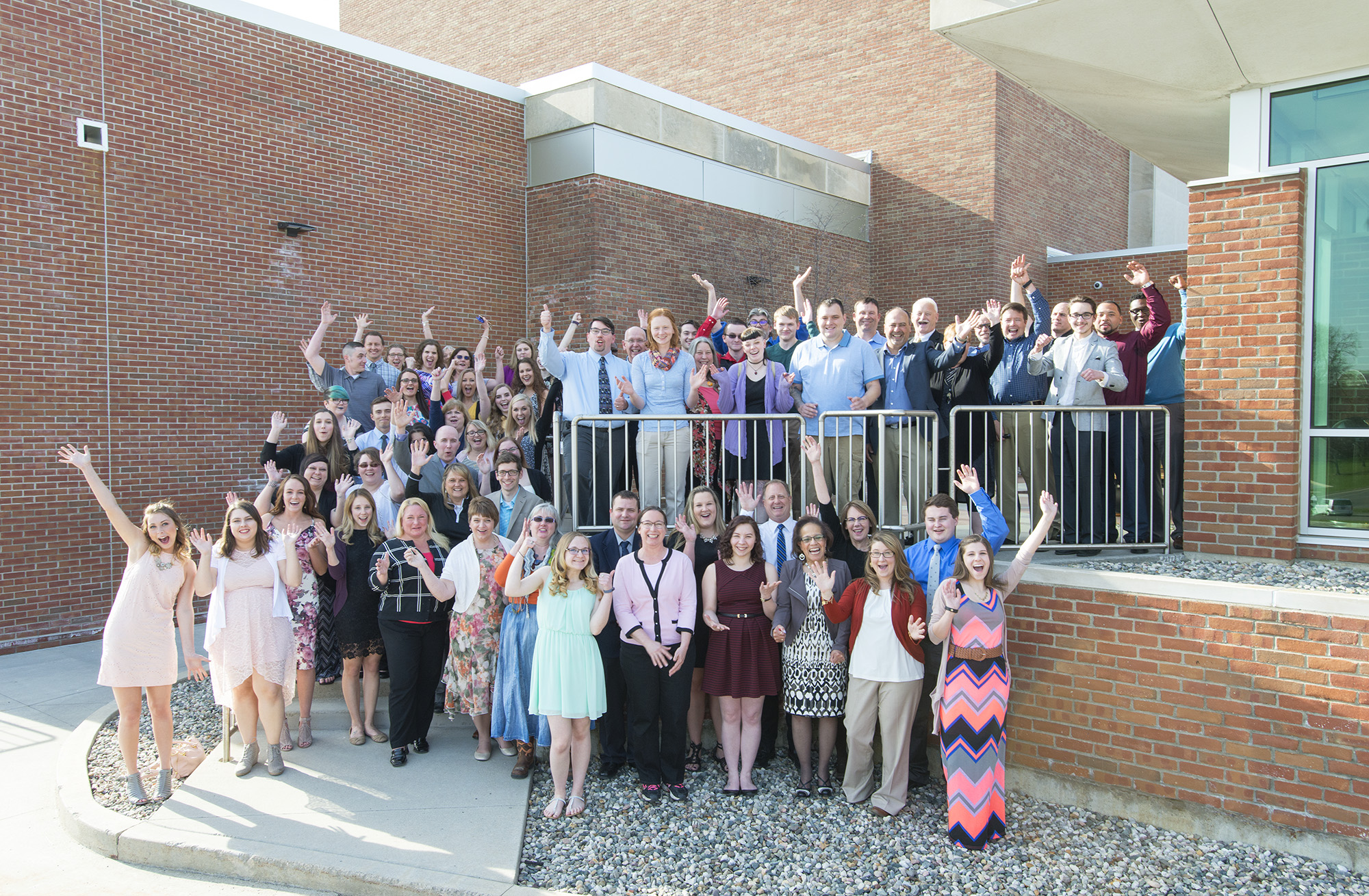 Student Outstanding Bruin Award recipients and staff presenters pose for a group photo outside the Kellogg Room on KCC's North Avenue campus in Battle Creek.