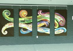 A photo of a colorful tapestry in the Binda lobby.