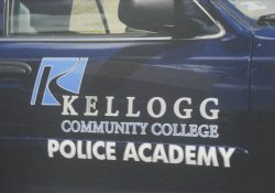 The side of a KCC Police Academy cruiser.