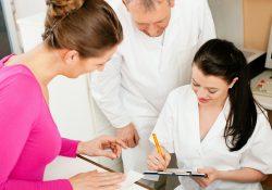 Medical staff assist a patient.