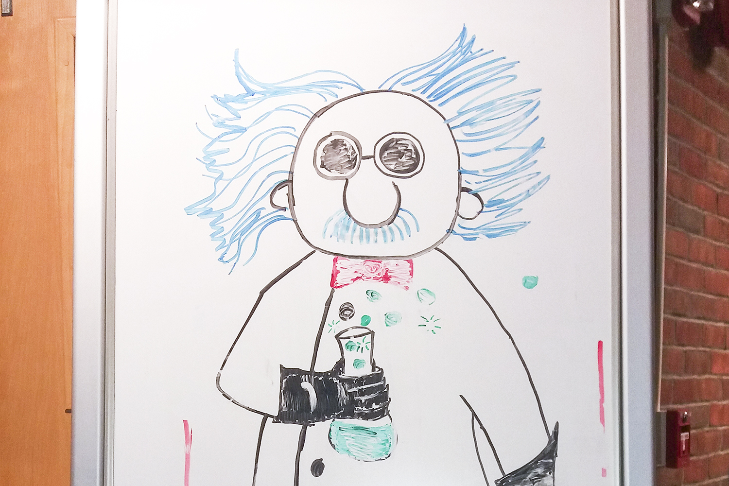 An illustration of a science professor drawn on a whiteboard.