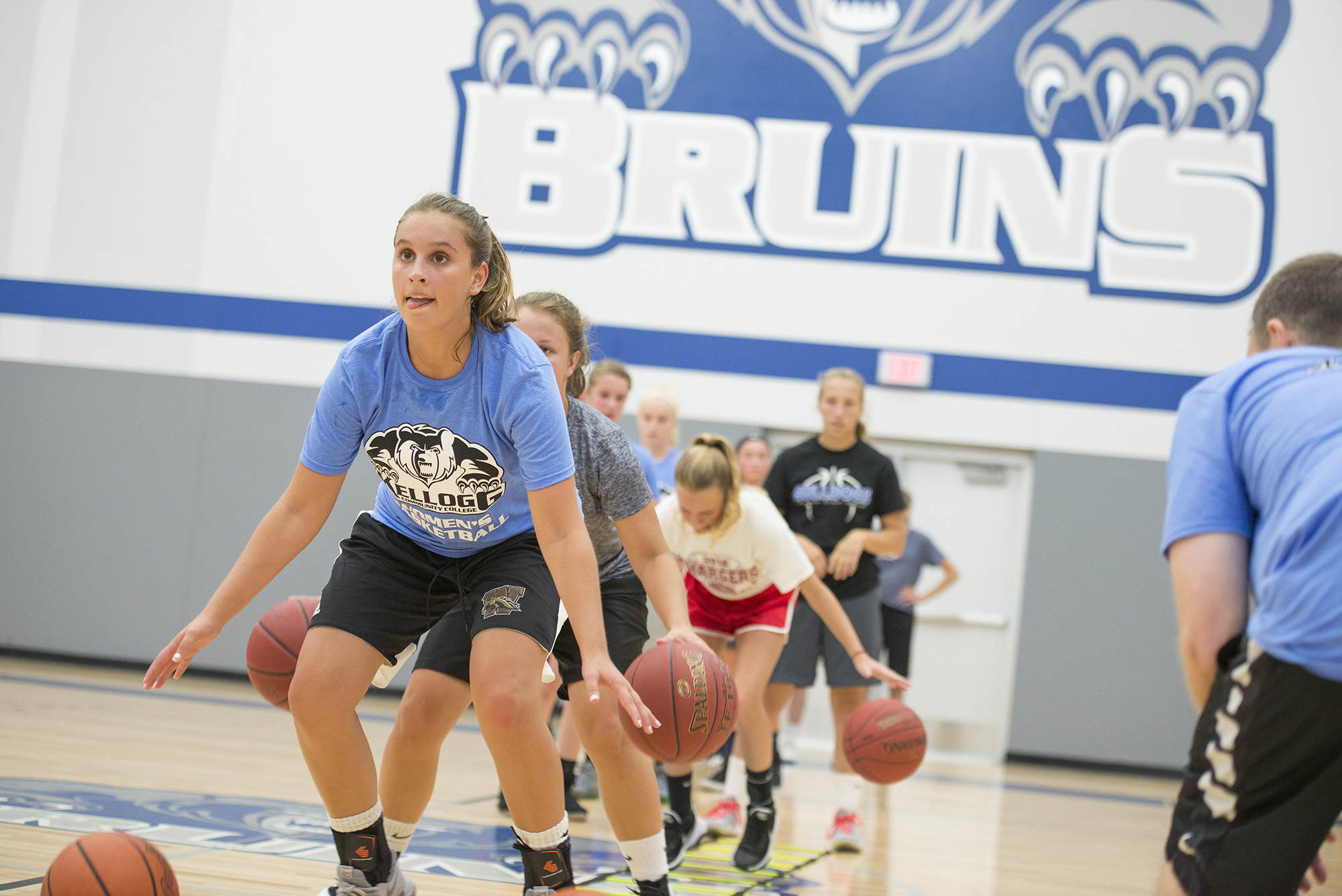 Participants in KCC's Girls' Basketball Camp work on drills in the Miller Gym.