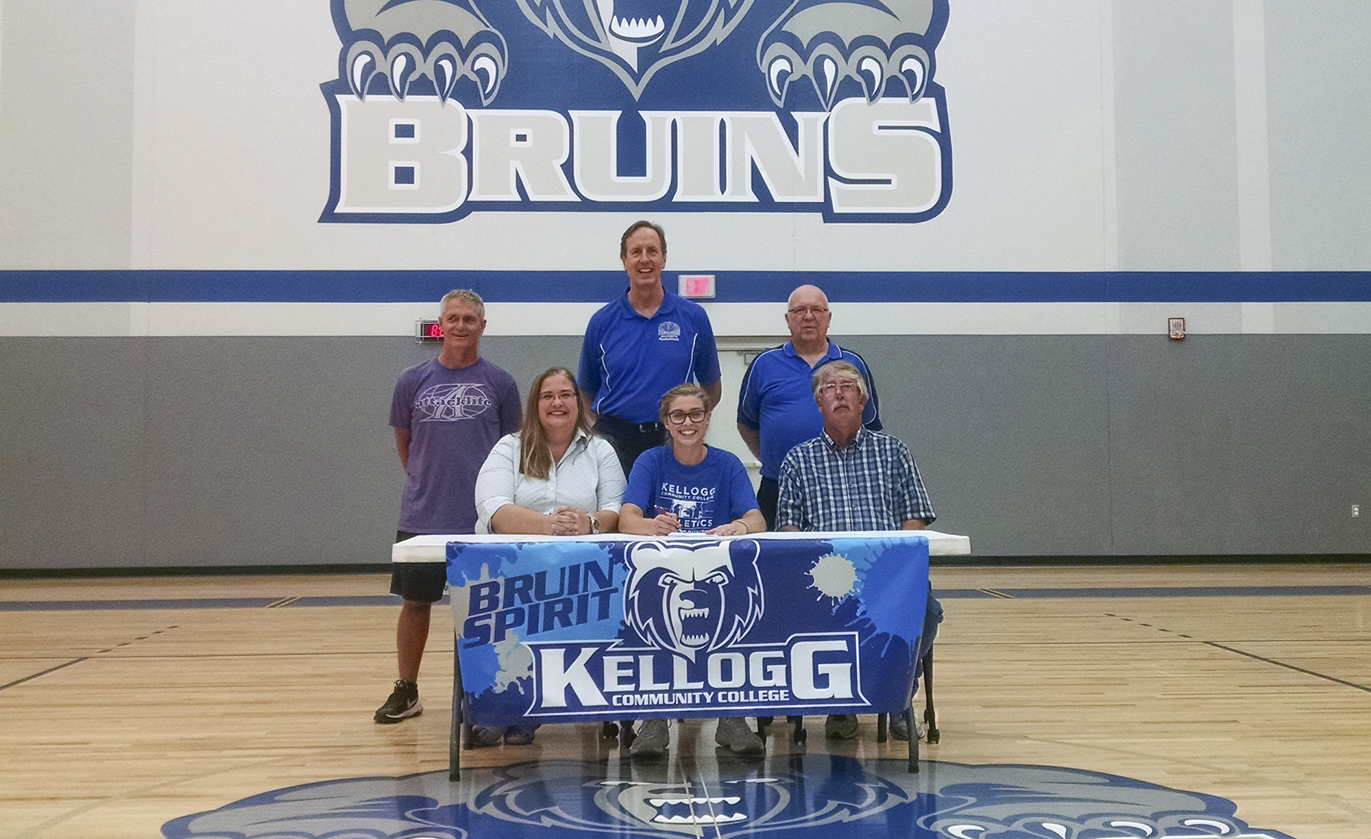 Pictured in the above athletic signing photo, in the front row, from left to right, are Angela Walton (mother), Morgan Walton and Larry Walton (father). In the back row, from left to right, are Attack Basketball Coach Alton Tucker, KCC Head Women's Basketball Coach Dic Doumanian and KCC Assistant Women's Basketball Coach Ray Miller.