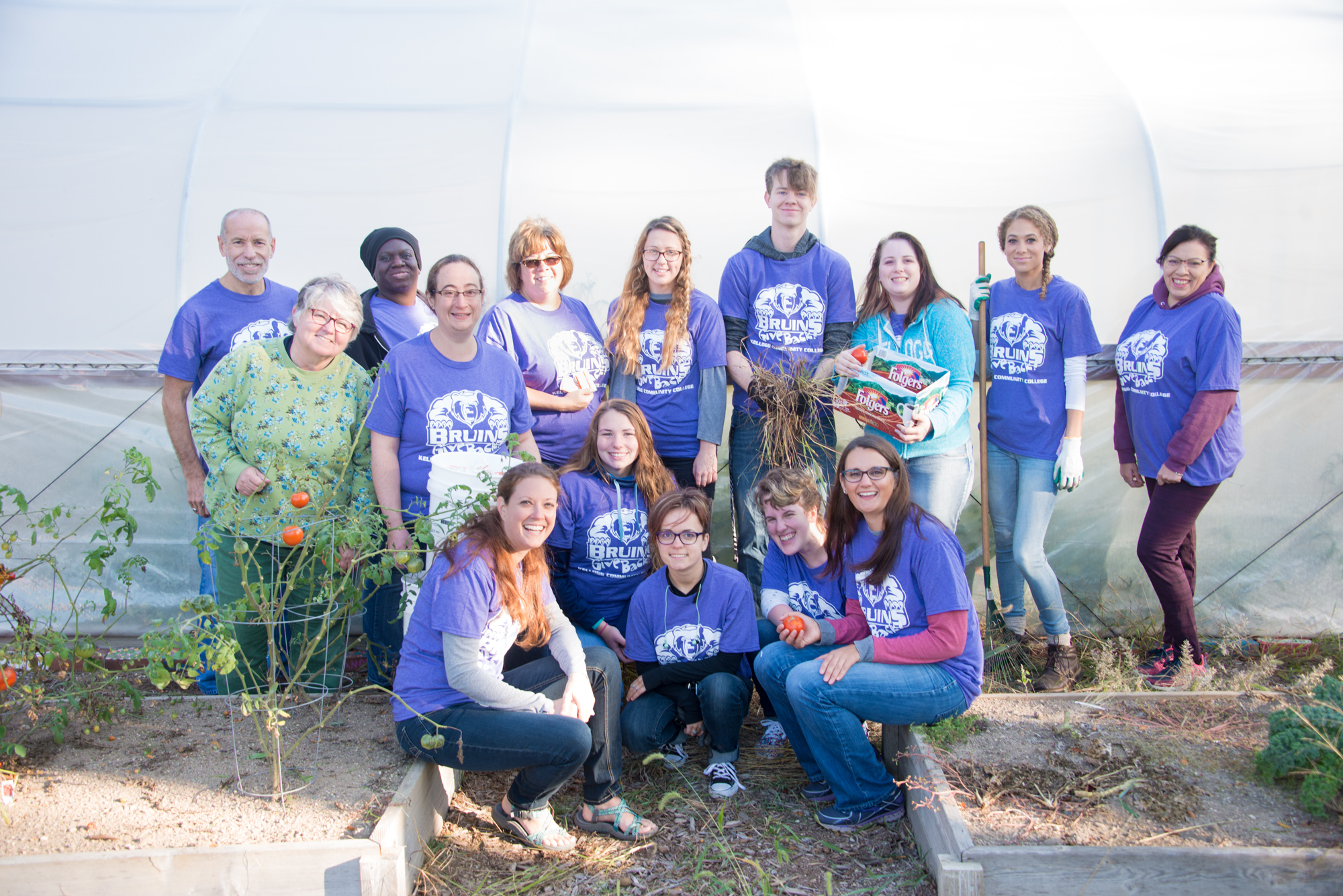 Bruins Give Back participants pose for a group photo in KCC's community garden.