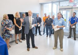 KCC President Mark O'Connell, front left, recognizes Al Bobrofsky, front right, during KCC's Miller Building open house and dedication event Aug. 7.