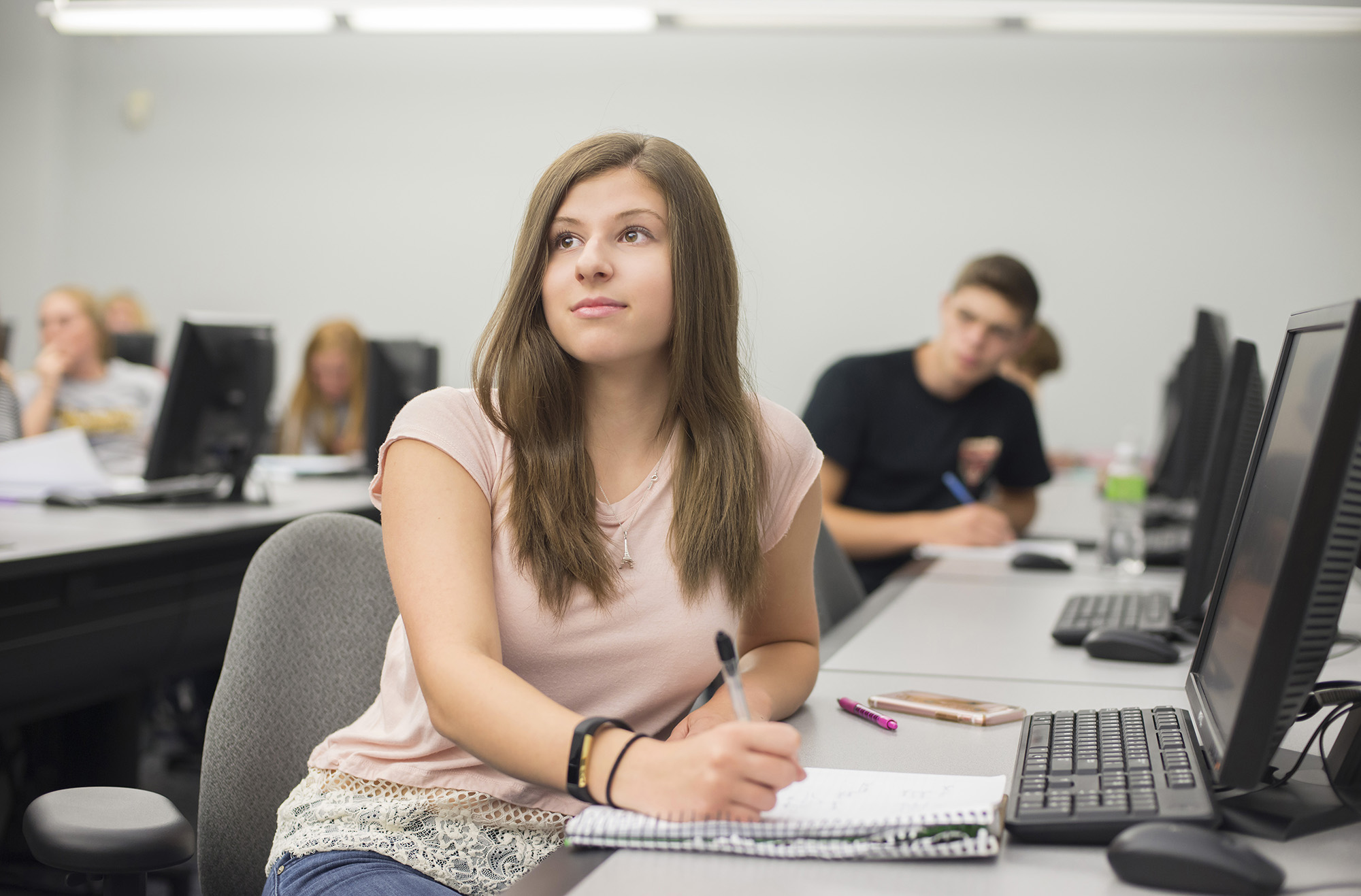 KCC business students take notes during a class.