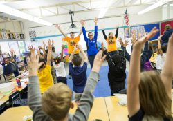 Bruins Give Back participants exercise with kids at Dudley STEM School.