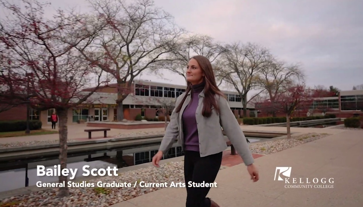 KCC student Bailey Scott walks outside on campus in Battle Creek in a screenshot from a recent KCC commercial.