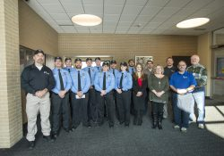 KCC Public Safety Education students and staff pose for a large group photo with S.A.F.E. Place shelter director and legal advocate Melissa Smith.