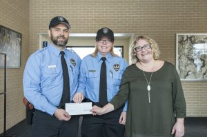 KCC Police Academy cadets, from left to right, Gabriel Weekly and Rachel Frommert, present Melissa Smith, shelter director and legal advocate at S.A.F.E. Place, with a donation of $300 from the College's Public Safety Education Department.