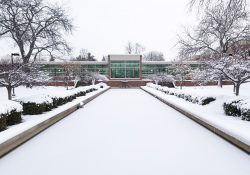 An exterior view of the main entrance to KCC's North Avenue campus in Battle Creek, blanketed in snow.