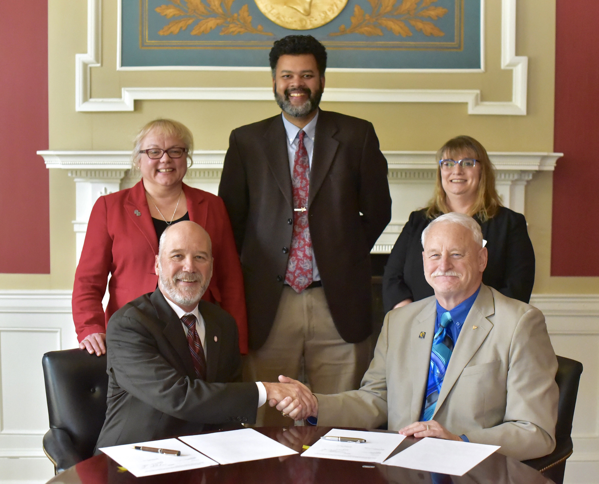 Olivet College and Kellogg Community College signed an agreement on Feb. 19 to expand the two institutions' nursing program partnership. Pictured seated, from left to right, are President Steven M. Corey, Ph.D., Olivet College; and President Mark O'Connell, Kellogg Community College. Standing, from left to right, are Provost and Dean of the College Maria G. Davis, Ph.D., Olivet College; Dr. Paul Watson, Kellogg Community College vice president of instruction; and Dr. Lorraine Manier, Olivet College director of nursing education.