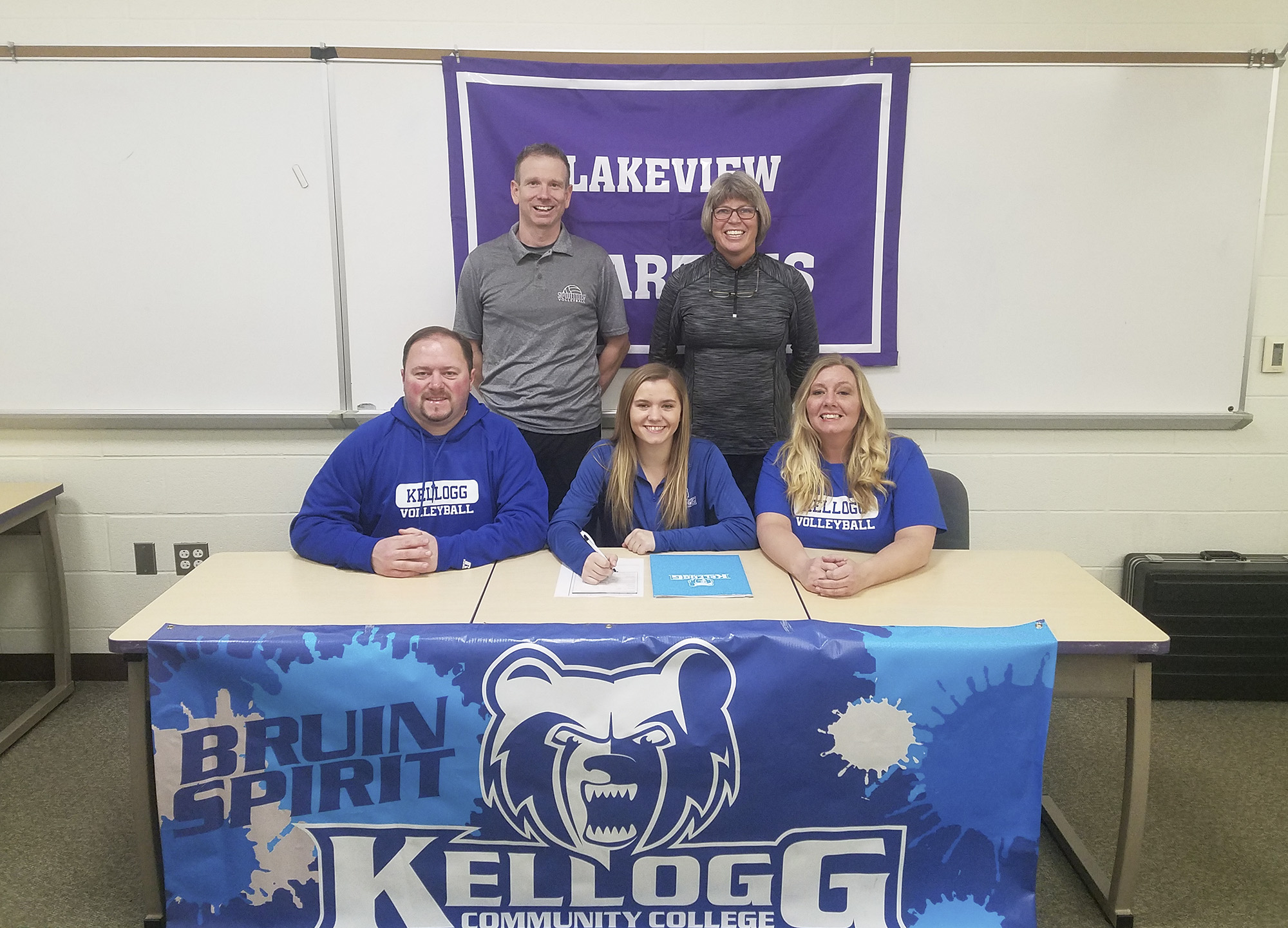 Pictured, in the front row, from left to right, are Eric Markos (father), KCC volleyball recruit Haidyn Markos and Courtney Markos (mother). Pictured in the back row, from left to right, are Lakeview High School coaches Jason Moore and Heather Sawyer.