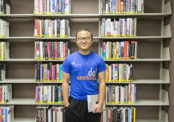 KCC alumnus Joseph Lin poses in the library as a student in 2015.