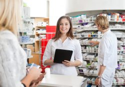 Stock photo of a female pharmacist working.