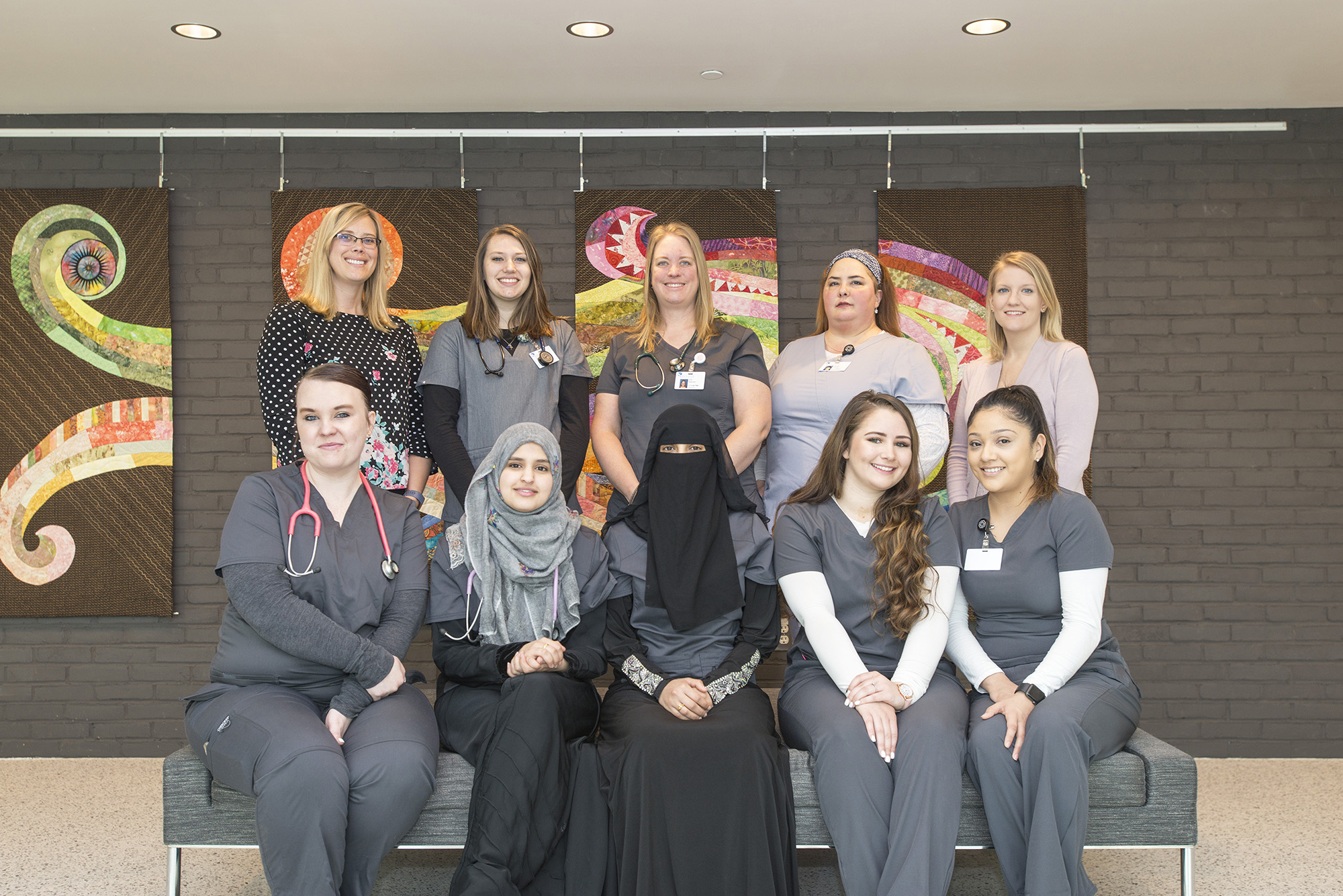 A group photo of KCC's first Medical Assistant Program graduates and their instructors.