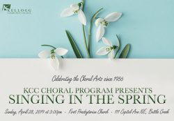 "Flowers and text on a text slide promoting KCC's upcoming ""Singing in the Spring"" choral concert."