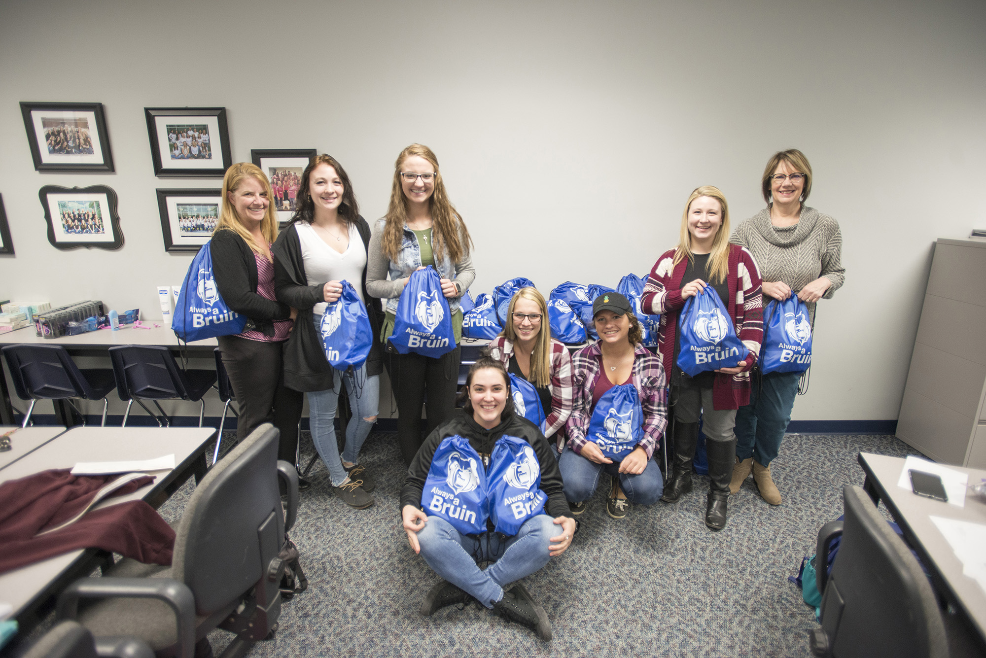 Dental Hygiene students and instructors pose with care packages they made for the homeless.