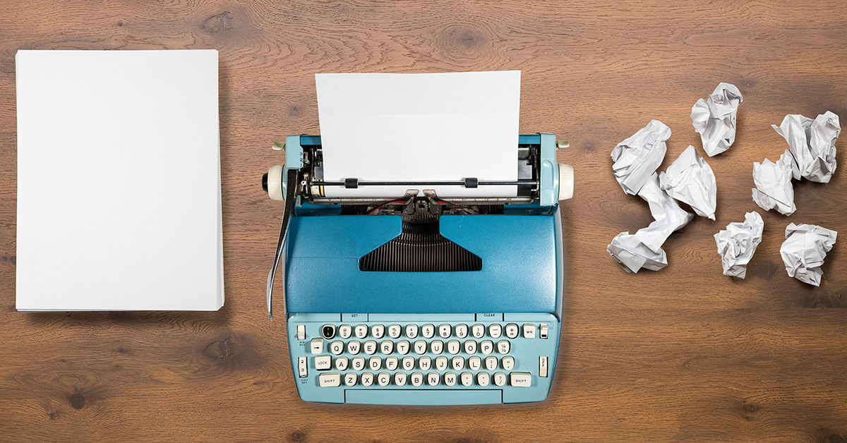 Blank paper, a typewriter and ball-up paper.