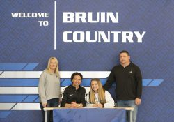 Pictured, from left to right, are Danielle Willis (mother), Head Women's Soccer Coach Eierí Salivia, Baylee Willis and Mitch Willis (father).